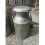 "MILK CHURN, 10 gallon aluminium twin handled milk churn with lid, 28"" high, stamped Unigate"