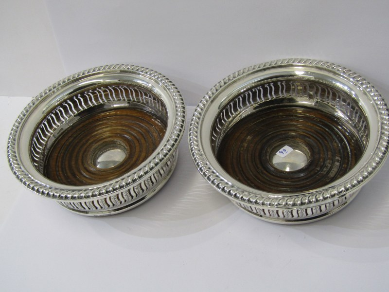 SILVER DECANTER COASTERS, pair of silver and stained beech frame decanter coasters of circular form,