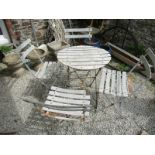 VINTAGE BISTRO SET, a metal framed circular slatted table with 4 matching chairs