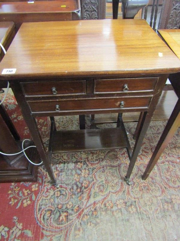 MAHOGANY TRIPLE DRAWER NEEDLEWORK TABLE, open shelf base with tapering square section legs and brass