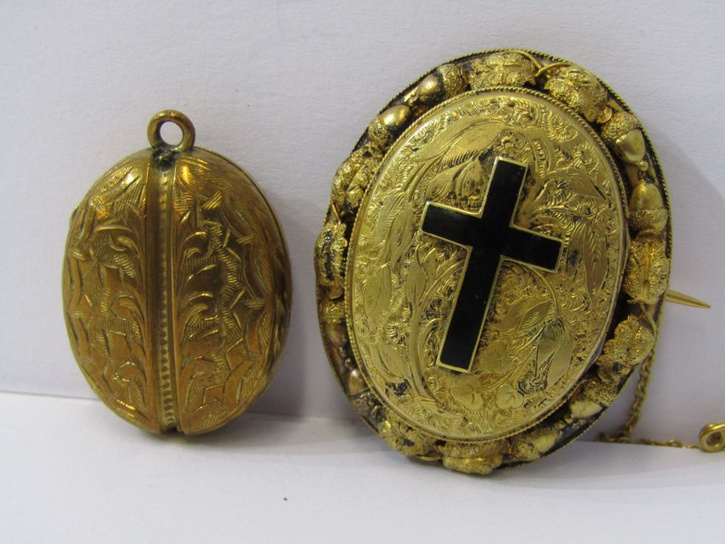 2 YELLOW METAL LOCKETS, 1 floral form with enamel cross and locket back, cross opens to reveal