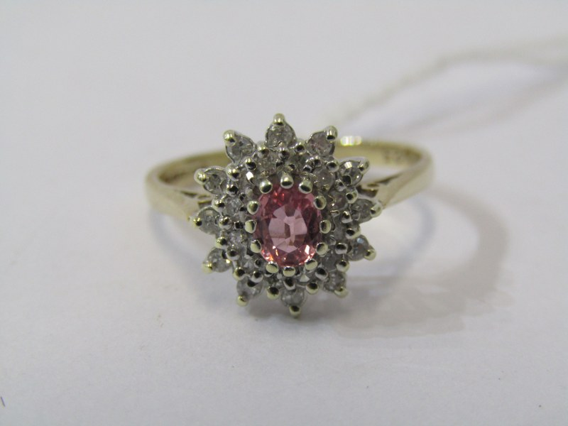 9ct YELLOW GOLD PINK SAPPHIRE & DIAMOND CLUSTER RING, principal oval cut pink sapphire surrounded by