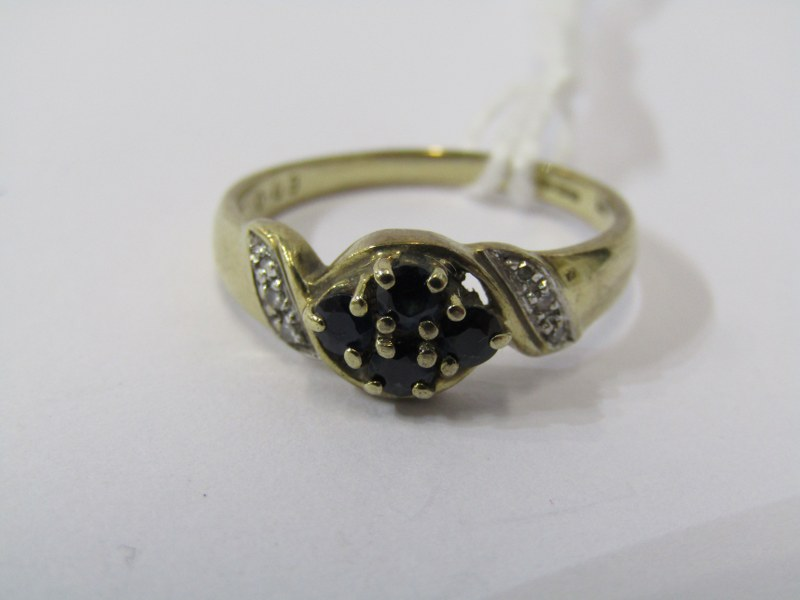 9CT YELLOW GOLD SAPPHIRE & DIAMOND CLUSTER RING, 4 principal sapphires, dark blue colour with accent