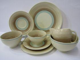 SUSIE COOPER, brown banded tea service of cream jug, sugar bowl, bread plate, 5 small cup trios, 2