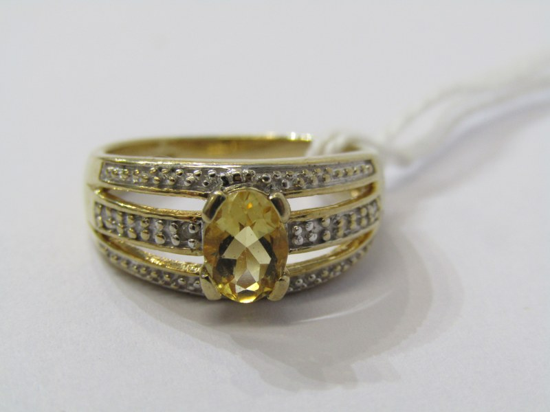 9CT YELLOW GOLD CITRINE & DIAMOND RING, principal oval cut citrine in 4 claw setting, set with
