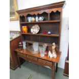 ANTIQUE MAHOGANY DRESSER, open shelf back rack above triple frieze drawer base with brass swan