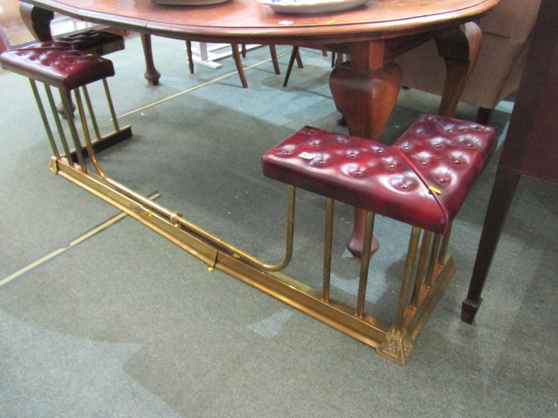 "ANTIQUE CLUB FENDER, red leather button upholstered seats on brass column supports, 67"" width"