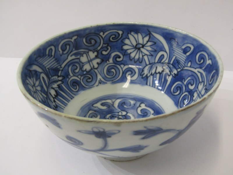 "ORIENTAL CERAMICS, early underglaze blue 5.5"" deep bowl decorated with floral and foliate design,"