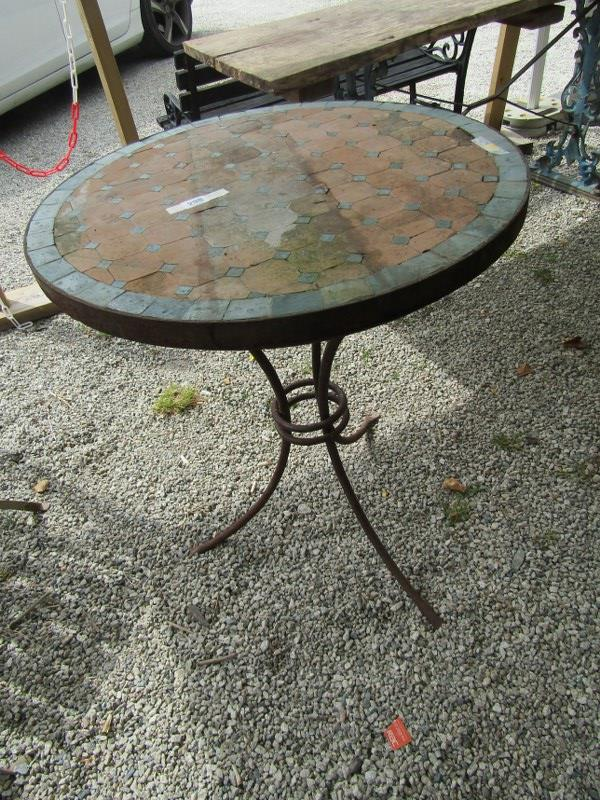 "ANTIQUE BISTRO TABLE, with tiled top on a metal 3 legged base, 24"" diameter"