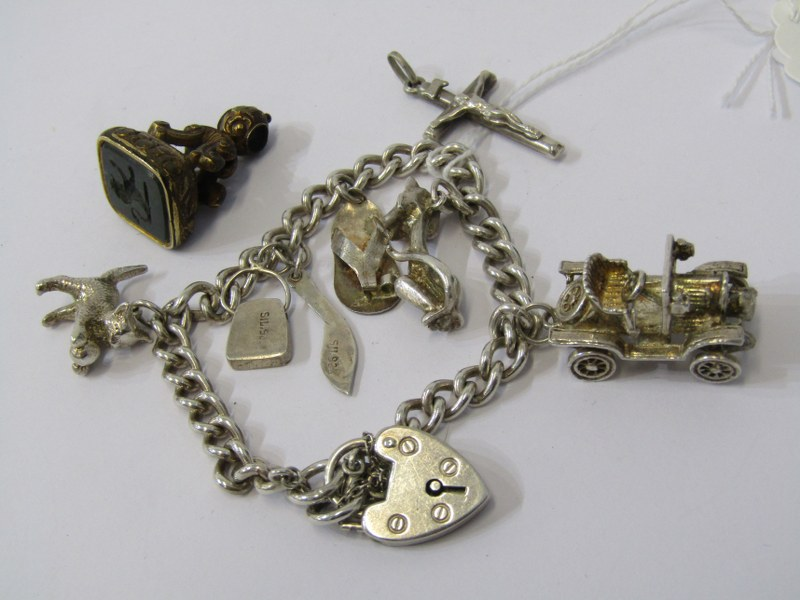 SILVER CHARM BRACELET WITH CHARMS & YELLOW METAL FOB, with intaglio carved lion rampant in