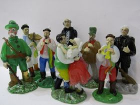 CZECHOSLOVAKIAN GLASS, an interesting collection of 8 coloured glass figures depicting village
