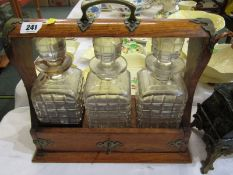 """EDWARDIAN TANTALUS, triple decanter tantalus with plated mounts and key, 13"""" width"""