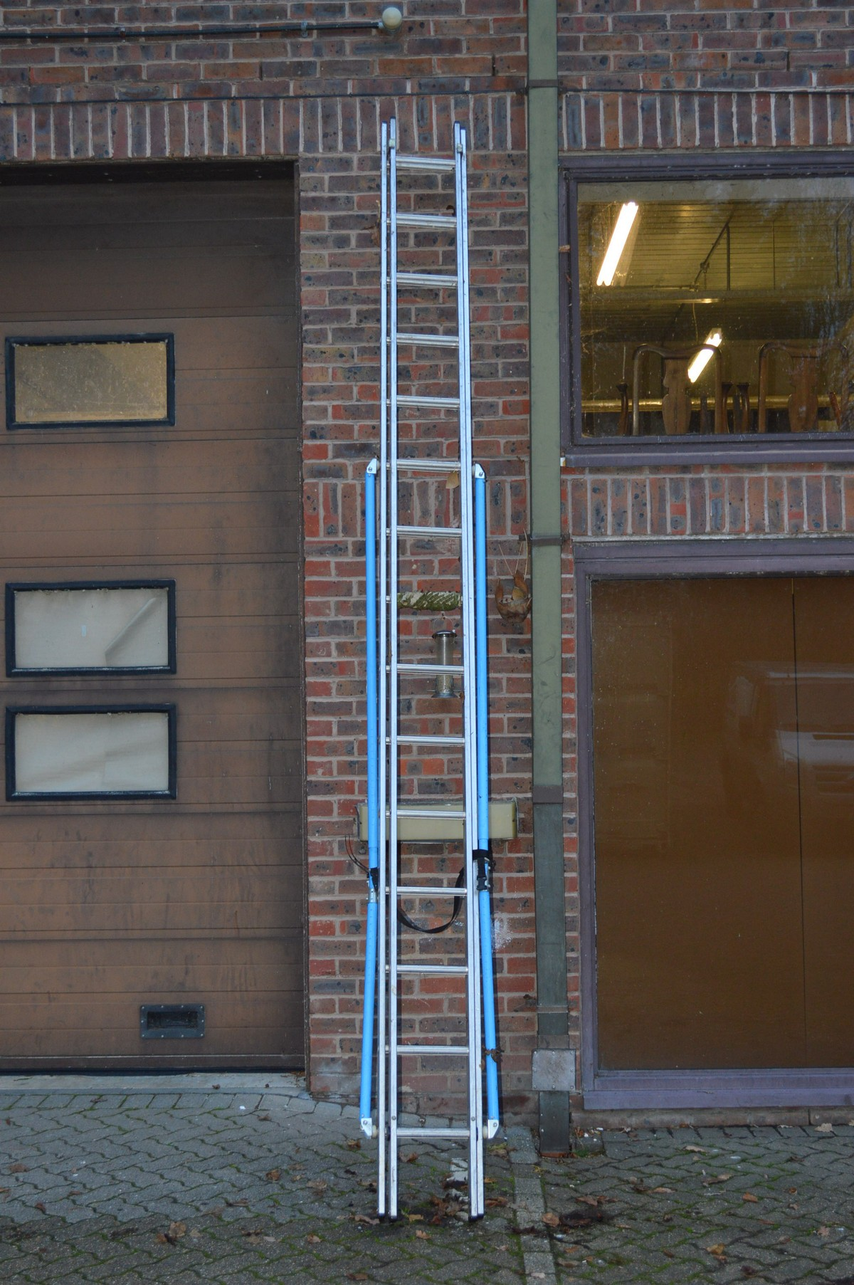 An aluminium extending ladder.
