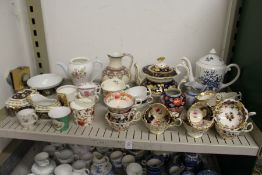A shelf of decorative tea ware etc.