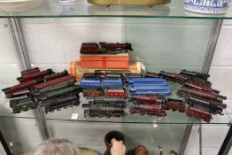 A collection of Hornby double OO gauge trains and carriages.