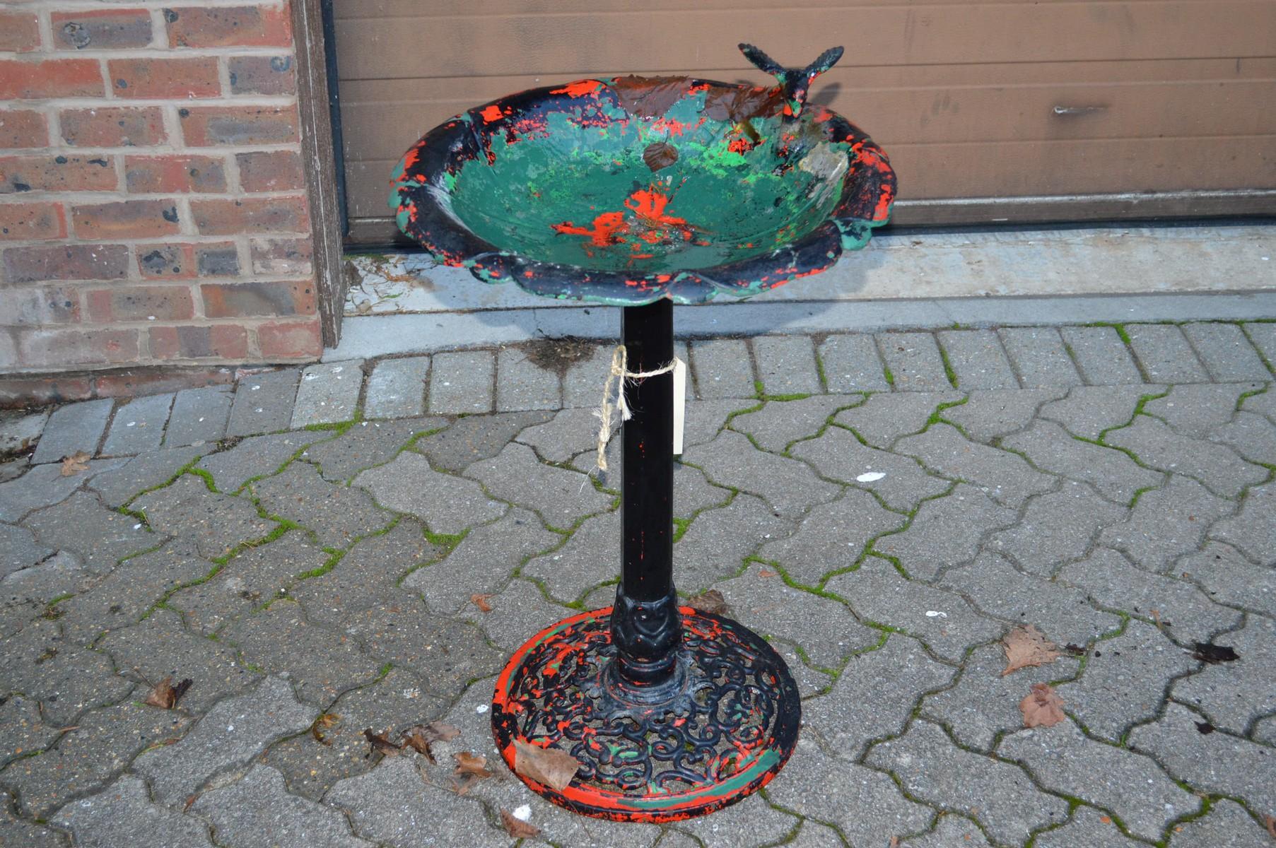 A metal bird bath.