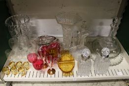 A pair of cut glass decanters with metal mounts possibly silver together with cut glass vases and