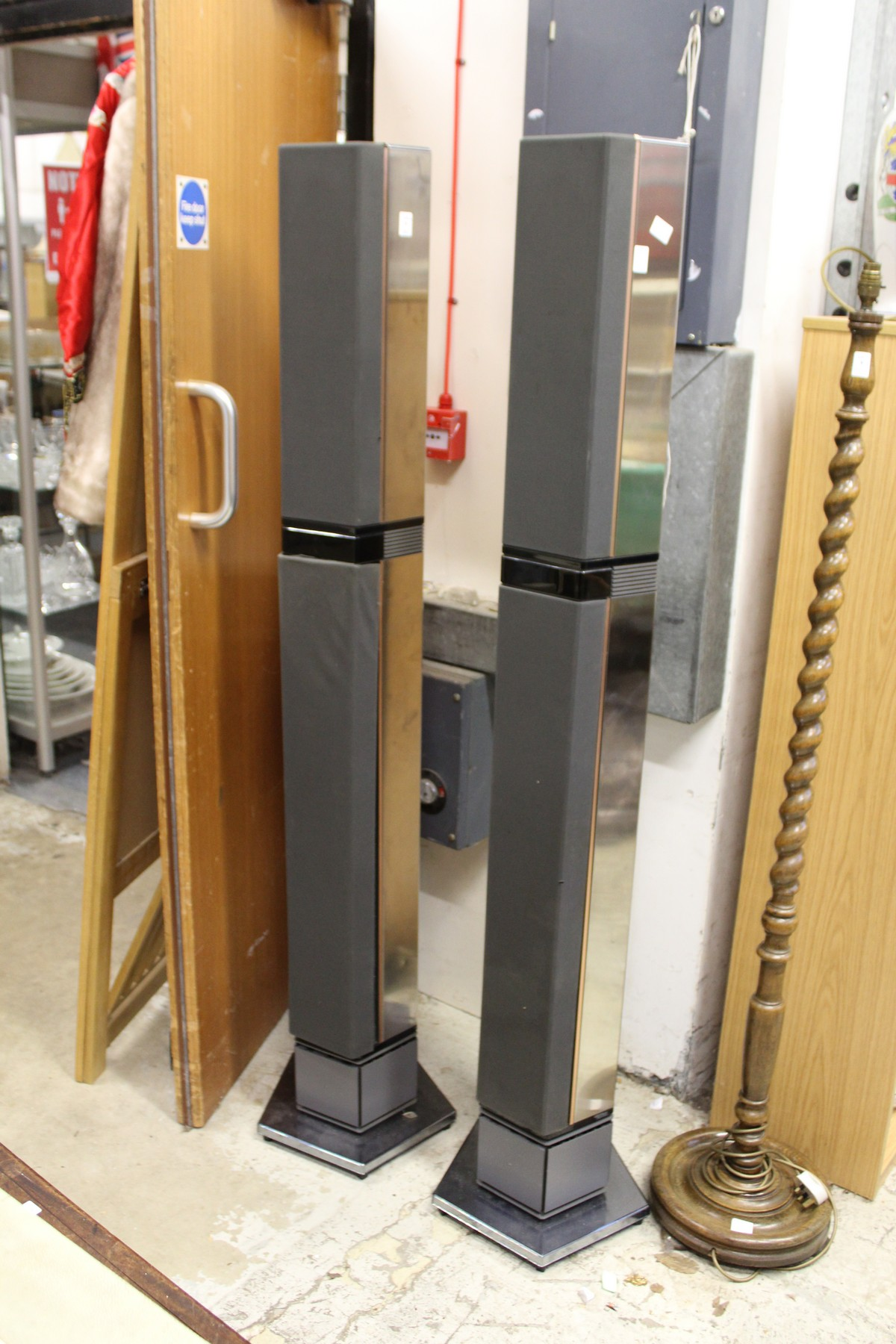 A pair of Bang & Olufsen tall column shaped speakers.
