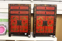 A pair of Chinese decorative lacquer small cabinets with two drawers and two cupboard doors.