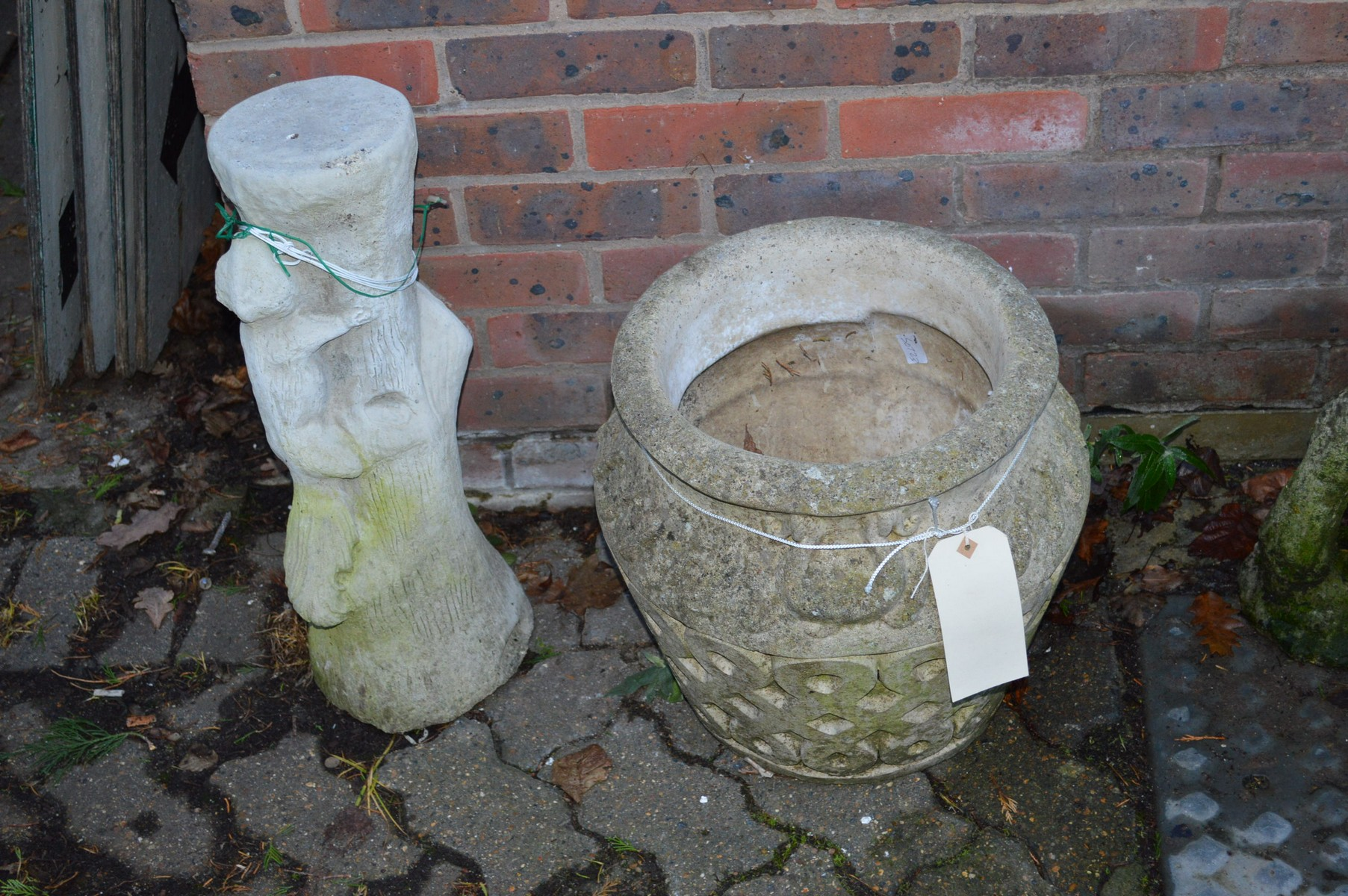 A reconstituted stone garden pot and a pot stand.