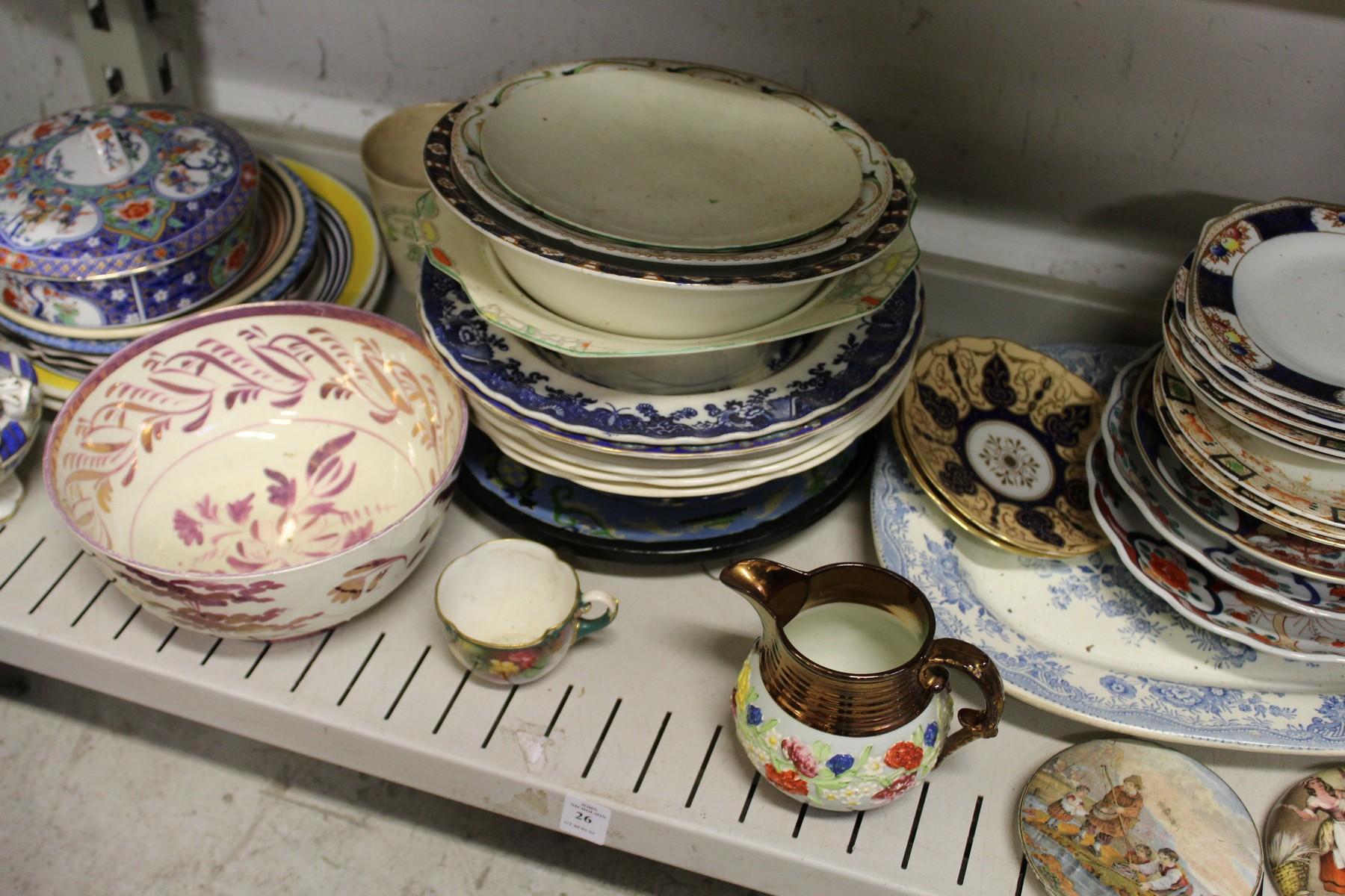 A shelf of decorative china.
