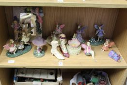Decorative resin models of fairies and similar items.