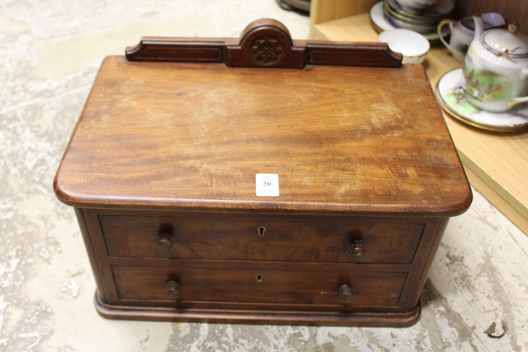A small mahogany two drawer table top chest.