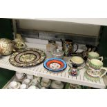 A quantity of Swiss Thoune decorative pottery items to include a ewer, various mugs, plates etc.