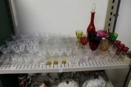 Cut glass champagne glasses, colourful glassware etc.