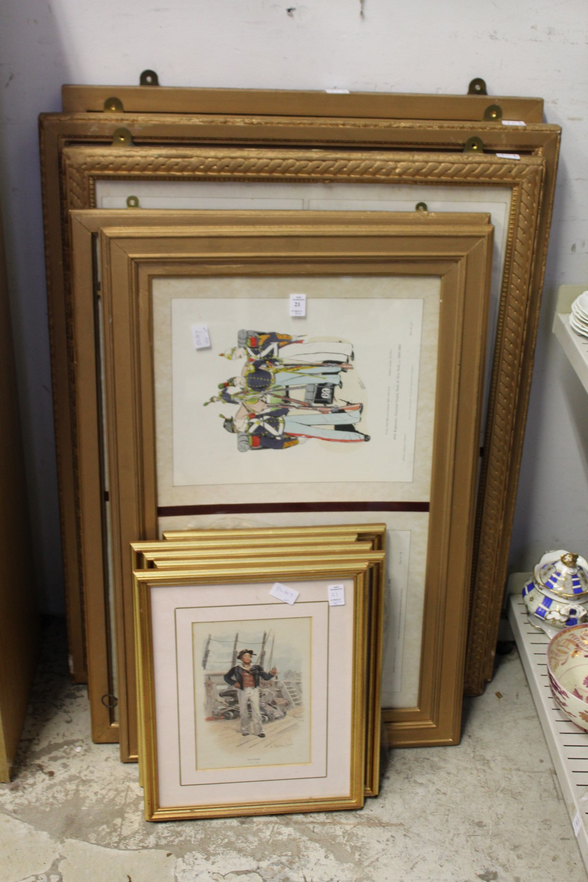 A quantity of military and naval figural prints, framed and glazed.