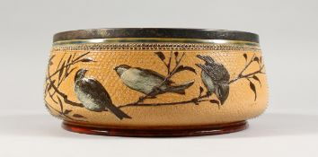 A LARGE DOULTON LAMBETH STONEWARE CIRCULAR FRUIT BOWL painted with birds. Maker F.E.B. No. 930. 1883