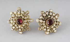 A PAIR OF CHANEL DIAMANTE AND RED STONE EAR CLIPS.