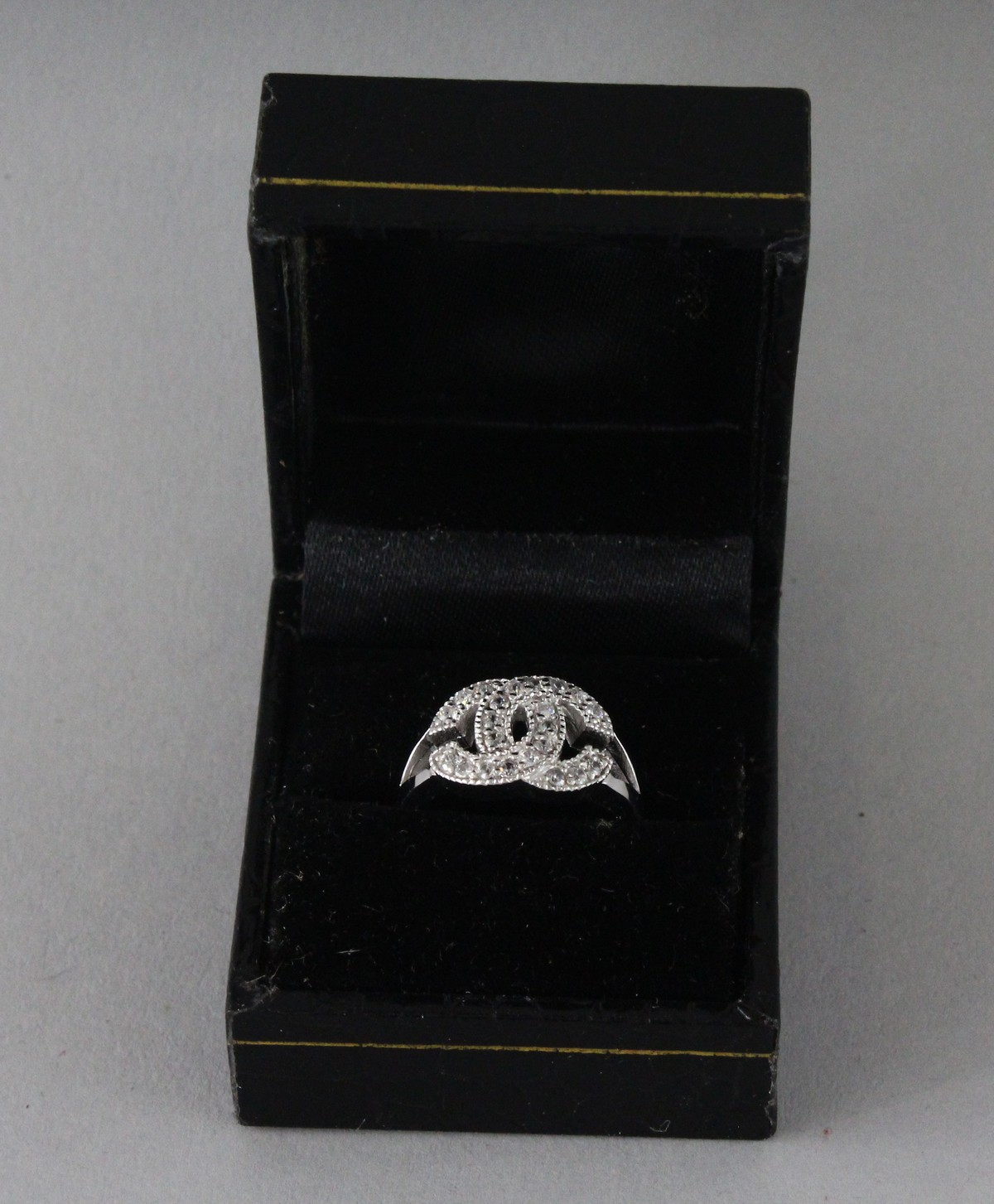 A CHANEL DESIGN SILVER AND CZ DOUBLE C RING. - Image 4 of 4