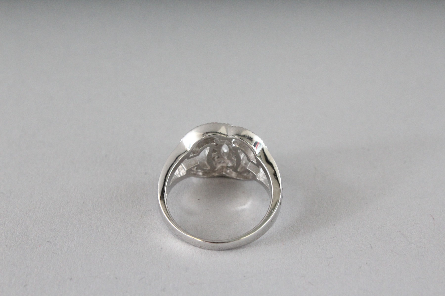 A CHANEL DESIGN SILVER AND CZ DOUBLE C RING. - Image 2 of 4