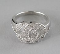A CHANEL DESIGN SILVER AND CZ DOUBLE C RING.