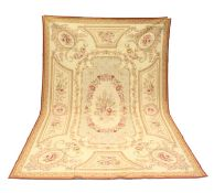 AN AUBUSSON STYLE TAPESTRY WALL HANGING, beige ground decorated with floral panels. 9ft 0ins x 6ft