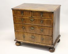 AN 18TH CENTURY WALNUT CHEST OF DRAWERS, with decoratively veneered top and drawers, boxwood