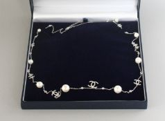 A CHANEL PATTERN SILVER, PEARL AND CZ LONG NECKLACE.