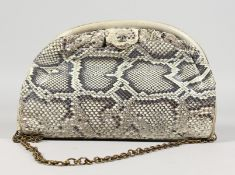 A CHANEL SNAKESKIN BAG with leather interior. Made in Italy. 11ins long.