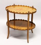 A GOOD SHERATON REVIVAL SATINWOOD AND MARQUETRY TWO TIER OVAL ETAGERE, the galleried top and