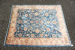 A ZIEGLER CARPET, 20th century, pale blue ground with stylised palmettes and floral decoration