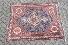 A GOOD SMALL QASHQAI RUG, early 20th century, cream ground central panel, stylised palmette design