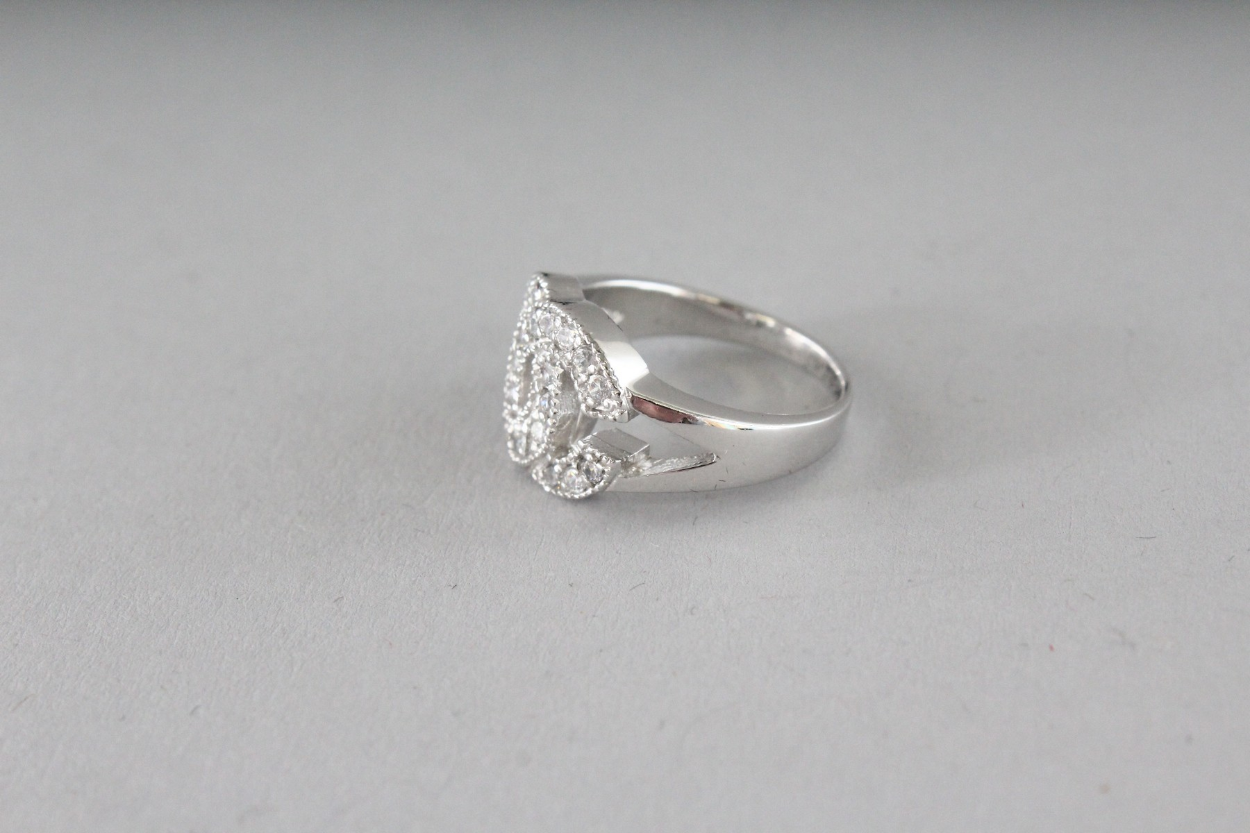 A CHANEL DESIGN SILVER AND CZ DOUBLE C RING. - Image 3 of 4