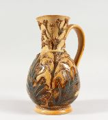 A DOULTON STONEWARE JUG by FRANK BUTLER, with leaves in relief. Maker F.A.B. 7.5ins high (AF).
