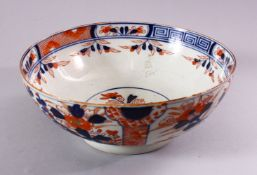 A JAPANESE EDO / MEIJI PERIOD IMARI PORCELAIN BOWL, decorated with panel displays of native flora
