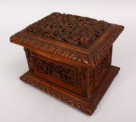 A GOOD 19TH CENTURY CHINESE CANTON CARVED WOODEN CASKET, the top carved with typical canton scenes