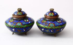 A PAIR OF 19TH / 20TH CENTURY CHINESE CLOISONNE LIDDED KORO, the body of the koro's decorated with a