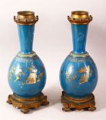 A PAIR OF 19TH CENTURY CHINESE PORCELAIN BOTTLE VASES / LAMP BASES, the ground with gilded