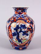 A JAPANESE MEIJI PERIOD IMARI PORCELAIN VASE, decorated with panel views of pine trees, phoenix