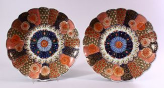 A PAIR OF JAPANESE MEIJI PERIOD IMARI PORCELAIN CHRYSANTHEMUM FORMED PLATES, each decorated with